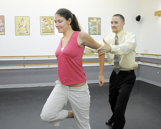 Amy McKellar and Evin Larsen rehearse their tango dance for Dancing with the Broomfield Stars at Dance Arts Studio.<br /> August 15, 2011<br /> staff photo/ David R. Jennings