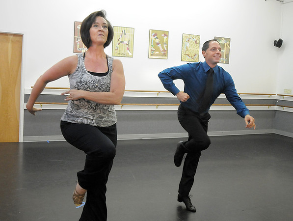 Jenifer Madson and Morris Vaccarella rehearse their  Ballroom Latin dance for Dancing with the Broomfield Stars at Dance Arts Studio.<br /> August 15, 2011<br /> staff photo/ David R. Jennings