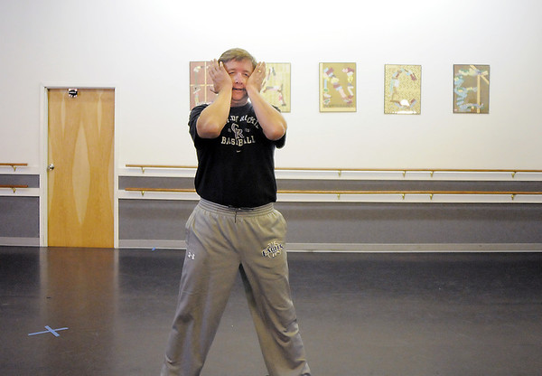 John Long takes a moment to prepare before dancing with CarleeTaga during rehearsal of their jazz dance for Dancing with the Broomfield Stars at Dance Arts Studio.<br /> <br /> August 15, 2011<br /> staff photo/ David R. Jennings