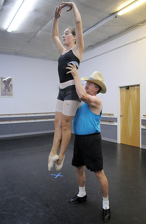 Randy Ahrens lifts Sophie Payannet during rehearsal for their dance which mixes country and ballet for Dancing with the Broomfield Stars at Dance Arts Studio.<br /> <br /> August 15, 2011<br /> staff photo/ David R. Jennings