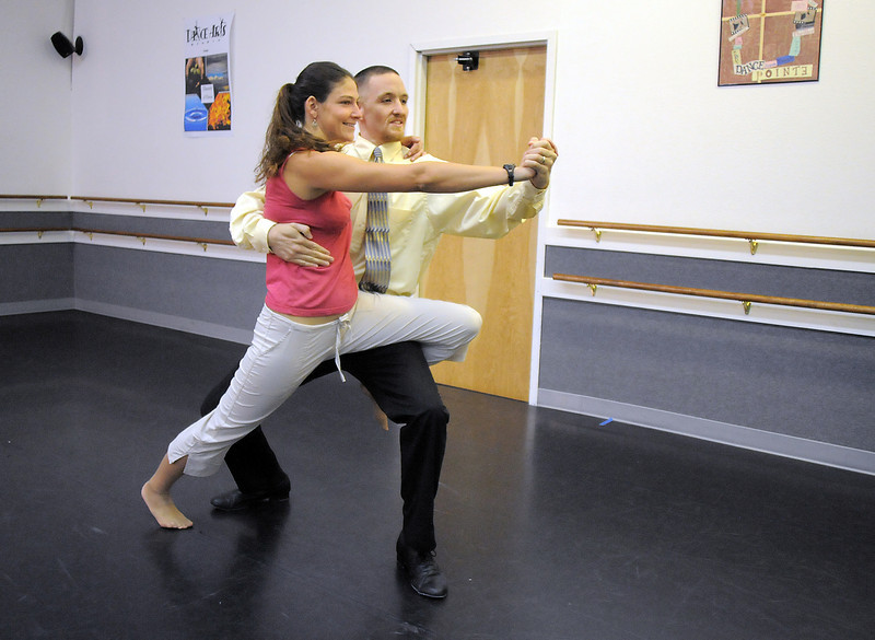Amy McKellar and Evin Larsen rehearse their tango dance for Dancing with the Broomfield Stars at Dance Arts Studio.<br /> <br /> August 15, 2011<br /> staff photo/ David R. Jennings