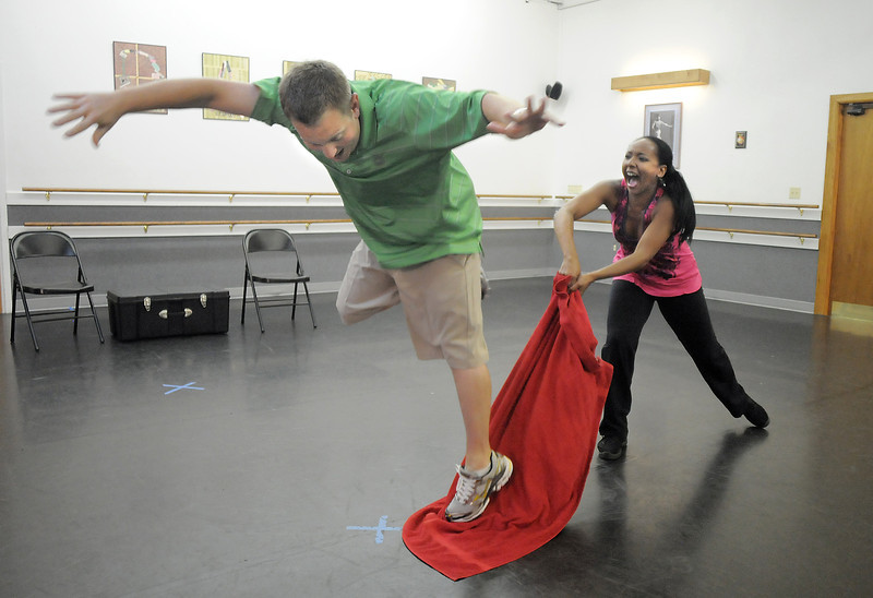 Andrew Bosio jumps as Jennifer Johnson pulls a towel from under him during rehearsal for their performance of a Jazz dance for Dancing with the Broomfield Stars at Dance Arts Studio.<br /> <br /> <br /> August 15, 2011<br /> staff photo/ David R. Jennings