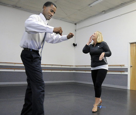 Linda Deland and Marcus Woods rehearse their performance of a swing-mix dance for Dancing with the Broomfield Stars at Dance Arts Studio.<br /> <br /> August 15, 2011<br /> staff photo/ David R. Jennings