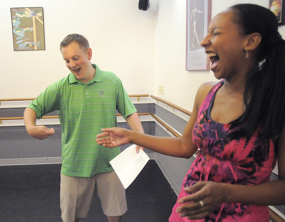 Andrew Bosio jokes with Jennifer Johnson before their rehearsal of a Jazz dance for Dancing with the Broomfield Stars at Dance Arts Studio.<br /> <br /> August 15, 2011<br /> staff photo/ David R. Jennings