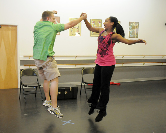 Andrew Bosio and Jennifer Johnson rehearse their performance of a jazz dance for Dancing with the Broomfield Stars at Dance Arts Studio.<br /> <br /> August 15, 2011<br /> staff photo/ David R. Jennings