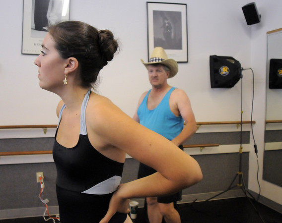 Sophie Payannet and  Randy Ahrens prepare to perform their dance which is a mix of country and ballet for Dancing with the Broomfield Stars during rehearsal at Dance Arts Studio.<br /> <br /> August 15, 2011<br /> staff photo/ David R. Jennings