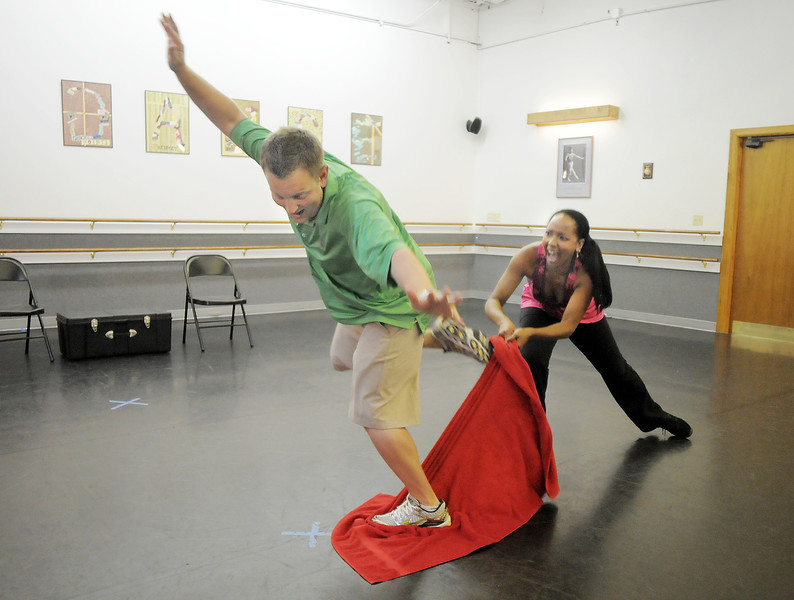 Andrew Bosio jumps as Jennifer Johnson pulls a towel from under him during rehearsal for their performance of a jazz dance for Dancing with the Broomfield Stars at Dance Arts Studio.<br /> <br /> August 15, 2011<br /> staff photo/ David R. Jennings