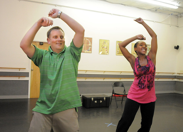 Andrew Bosio and Jennifer Johnson rehearse their performance of a jazz dance for Dancing with the Broomfield Stars at Dance Arts Studio.<br /> August 15, 2011<br /> staff photo/ David R. Jennings