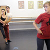 Heather Drake and Collin Eckhoff get pointers from Ballet Nouveau Colorado's Julia Wilkinson Manley during rehearsal of their Solid Gold 80's Jazz Disco dance for Dancing with the Broomfield Stars at Dance Arts Studio.<br /> <br /> August 15, 2011<br /> staff photo/ David R. Jennings