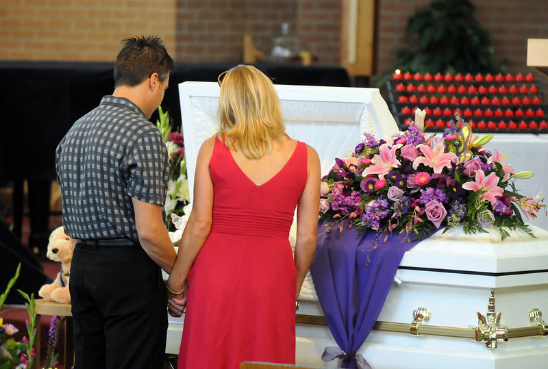 Friends of Amanda Peebles pay their final respects during Amanda's memorial service at Broomfield United Methodist Church on Friday.<br /> August 20, 2010<br /> staff photo/David R. Jennings