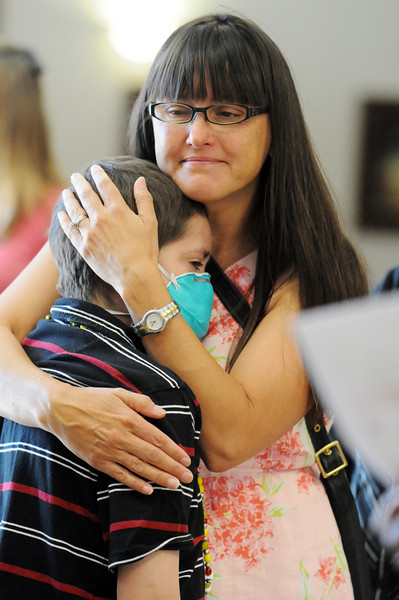REMEMBERING HIS FRIEND: Donavan Ariza, a cancer patient who bonded with Amanda through a pane of glass at Children s Hospital, recalled her as the kindest girl you know, is comforted by Paula Besman at Amanda's memorial service. <br /> August 20, 2010<br /> staff photo/David R. Jennings