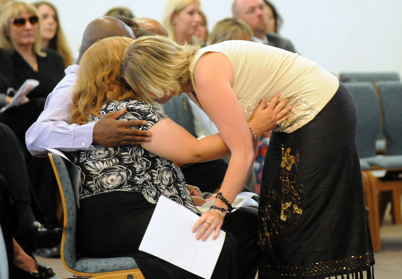 Michelle Peebles, left, mother of Amanda, is comforted by Stacy Miller Moriarty during the memorial service at Broomfield United Methodist Church on Friday.<br /> August 20, 2010<br /> staff photo/David R. Jennings