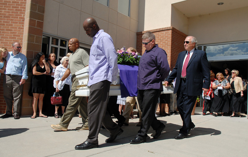 Pallbearers carry Amanda Pebbles out of the Broomfield United Methodist Church to be buried at the Broomfield County Commons Cemetery on Friday. The pallbearers were lead by Amanda's father Arlando, second left,  and her Uncle George, left, with other family members.<br /> August 20, 2010<br /> staff photo/David R. Jennings