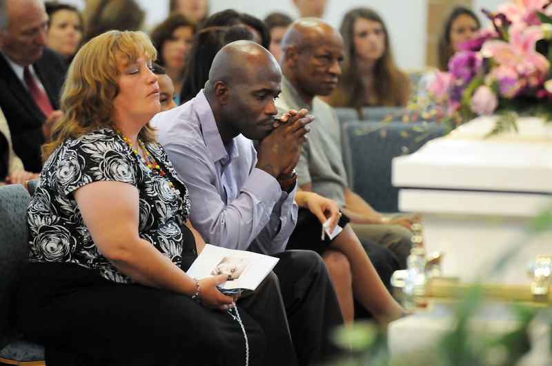 Michelle and Arlando Peebles listen as their daughter Amanda is remembered during the memorial service on Friday at Broomfeild United Methodist Church.<br /> August 20, 2010<br /> staff photo/David R. Jennings