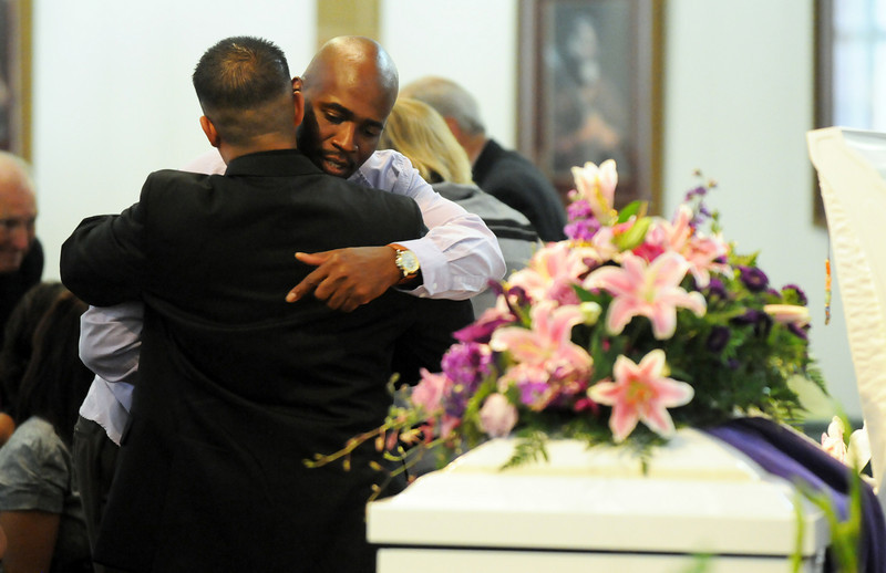 Arlando Peebles father of Amanda is comforted by a friend during the memorial service at Broomfield United Methodist Church on Friday.<br /> August 20, 2010<br /> staff photo/David R. Jennings