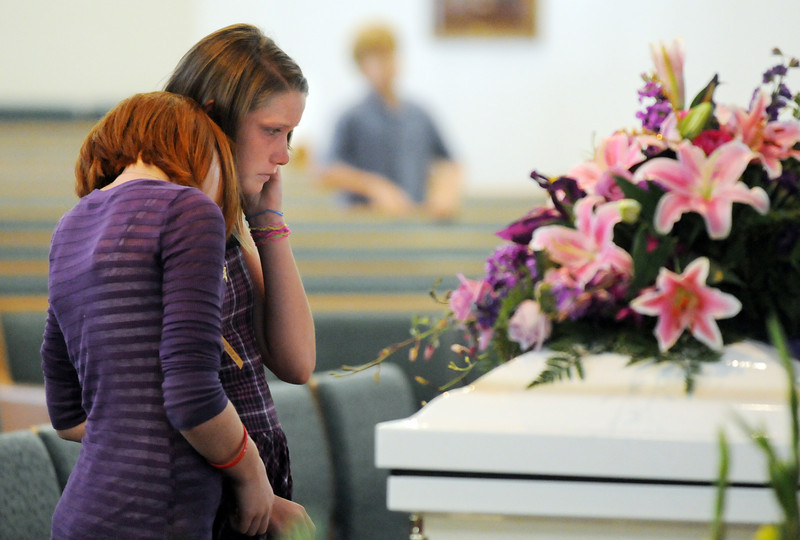 BE0822AMANDA05<br /> Kerrigan Bougher, left, and Kylie Sexton pay their final respects to their friend Amanda Peebles during Amanda's memorial service at Broomfield United Methodist Church on Friday.August 20, 2010<br /> staff photo/David R. Jennings