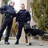 Retiring Broomfield Police officer Jason Collins, right, and his K-9 dog Nik share memories with Chief Tom Deland before  the retirement ceremony for Collins and Nik in front of police headquarters on Wednesday.<br /> <br /> December 1, 2010<br /> staff photo/David R. Jennings