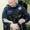 Broomfield Police officer Jason Collins gives his K-9 dog Nik a hug during the retirement ceremony of Collins and Nik from the department in front of police headquarters on Wednesday.<br /> <br /> December 1, 2010<br /> staff photo/David R. Jennings