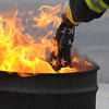 The stars are burned in a separate barrel from the strip for the  retirement ceremony at North Metro Fire Rescue Station 61 in Broomfield.<br /> <br /> July 2, 2009<br /> staff photo/David R. Jennings