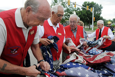 Broomfield Veteran's Museum  members Larry Hasty, left, Bob Davis, Bob Davenport and Bob Seeber help prepare the 551 flags for retirement during ceremony at North Metro Fire Rescue Station 61 in Broomfield.  July 2, 2009 staff photo/David R. Jennings