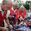 Broomfield Veteran's Museum  members Larry Hasty, left, Bob Davis, Bob Davenport and Bob Seeber help prepare the 551 flags for retirement during ceremony at North Metro Fire Rescue Station 61 in Broomfield.<br /> <br /> July 2, 2009<br /> staff photo/David R. Jennings