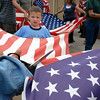Jacob Krol, 6, helps hold a flag while Emil Gimeno, 10, cuts the frild of stars from the flag for retirement during the ceremony at North Metro Fire Rescue Station 61 in Broomfield.<br /> <br /> July 2, 2009<br /> staff photo/David R. Jennings