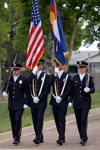The Broomfield Police honor guard of John Frahm, left, Todd Dahlbach, Clint Hess and Carol Lucero present the colors during the 5th annual Broomfield Veteran's Museum and North Metro Fire Rescue flag retirement ceremony at North Metro Fire Rescue Station 61 in Broomfield.  July 2, 2009 staff photo/David R. Jennings