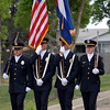The Broomfield Police honor guard of John Frahm, left, Todd Dahlbach, Clint Hess and Carol Lucero present the colors during the 5th annual Broomfield Veteran's Museum and North Metro Fire Rescue flag retirement ceremony at North Metro Fire Rescue Station 61 in Broomfield.<br /> <br /> July 2, 2009<br /> staff photo/David R. Jennings