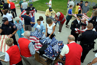 Firefighters, police, veterans and bystanders help retire 551during Thursday's 5th annual Broomfield Veteran's Museum and North Metro Fire Rescue flag retirement ceremony at North Metro Fire Rescue Station 61 in Broomfield.  July 2, 2009 staff photo/David R. Jennings