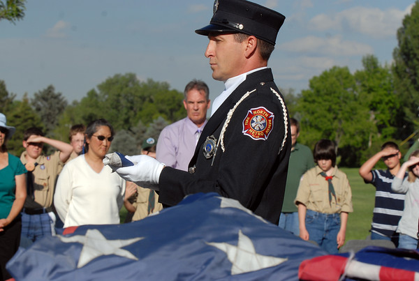 North Metro Fire Rescue engineer Frank Canino presents the first flag of the 515.5 flags to be retired during the 2010 Flag Retirement Ceremony at North Metro Fire Station 61 on Monday, Flag Day.  North Metro Fire Rescue and the Broomfield Veteran's Memorial Museum sponsored the Flag Day event.<br /> <br /> June 14, 2010<br /> Staff photo/ David R. Jennings