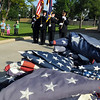 The combined Broomfield Police and North Metro Fire Honor Guard present the colors for the 515.5 flags to be retired in the foreground during the 2010 Flag Retirement Ceremony at North Metro Fire Station 61 on Monday, Flag Day.  North Metro Fire Rescue and the Broomfield Veteran's Memorial Museum sponsored the Flag Day event. Someone turned in half of a flag.<br /> <br /> June 14, 2010<br /> Staff photo/ David R. Jennings