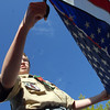 Boy Scout Stuart Shirley, 14, with Troop 511, cuts away the stars from a flag during the 2010 Flag Retirement Ceremony at North Metro Fire Station 61 on Monday, Flag Day.  North Metro Fire Rescue and the Broomfield Veteran's Memorial Museum sponsored the Flag Day event.<br /> <br /> June 14, 2010<br /> Staff photo/ David R. Jennings