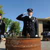North Metro Fire Rescue Engineer Frank Canino, center, flanked by Lt. Curtis Krantz, left, and Division Cheif Kevin Sweeney salute as the first flag burns during the 2010 Flag Retirement Ceremony at North Metro Fire Station 61 on Monday, Flag Day.  North Metro Fire Rescue and the Broomfield Veteran's Memorial Museum sponsored the Flag Day event.<br /> <br /> June 14, 2010<br /> Staff photo/ David R. Jennings
