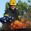 Firefighter Stephen Bostwick places the stars of the flag into a fire during the 2010 Flag Retirement Ceremony at North Metro Fire Station 61 on Monday, Flag Day.  North Metro Fire Rescue and the Broomfield Veteran's Memorial Museum sponsored the Flag Day event.<br /> <br /> June 14, 2010<br /> Staff photo/ David R. Jennings