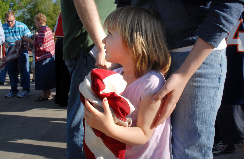 Katelyn Bodine, 3, holds strips of a flag that will be burned by firefighters during the 2010 Flag Retirement Ceremony at North Metro Fire Station 61 on Monday, Flag Day.  North Metro Fire Rescue and the Broomfield Veteran's Memorial Museum sponsored the Flag Day event.<br /> <br /> June 14, 2010<br /> Staff photo/ David R. Jennings