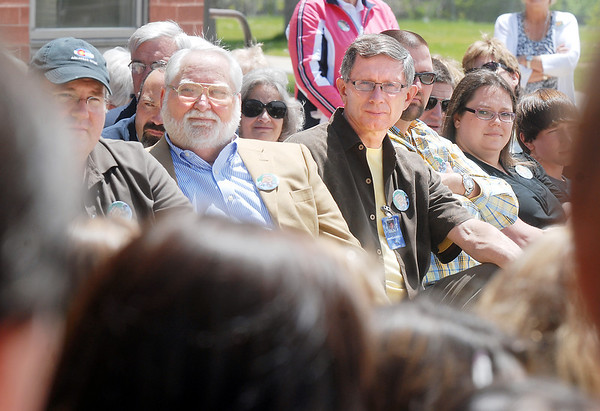 Retiring Broomfield Heights Middle School science teacher Robert Croft, right, and former principal John Ortner listen to the BHMS concert choir during the Robert Croft Day celebration at the school on Friday.<br /> May 20, 2011<br /> staff photo/David R. Jennings