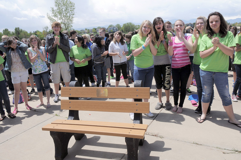 Students give an ovation for retiring Broomfield Heights Middle School science teacher Robert Croft during the Robert Croft Day celebration at the school on Friday. The bench is dedicated to Croft and will be installed at the school. <br /> May 20, 2011<br /> staff photo/David R. Jennings