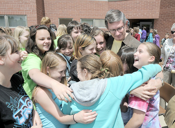 Broomfield Heights Middle School students surround retiring science teacher Robert Croft with a hug after the Robert Croft Day celebration at the school on Friday.  Croft is retiring after 41 years of service.<br /> May 20, 2011<br /> staff photo/David R. Jennings