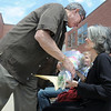 Retiring Broomfield Heights Middle School science teacher Robert Croft gives his wife Tonya a bouquet of roses during the Robert Croft Day celebration at the school on Friday. Croft would give his wife one rose every Friday.<br /> May 20, 2011<br /> staff photo/David R. Jennings