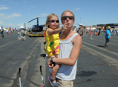 Julie Powll and her daughter Ava, 2 1/2, from Highlands Ranch, watch airplane performances during Saturday's Rocky Mountain Airshow at Rocky Mountain Metropolitan Airport. August 27, 2011 staff photo/ David R. Jennings