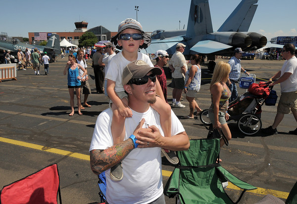 Greg Wirt and his son George, 4 1/2, from Lafayette, watch aircraft performances during Saturday's Rocky Mountain Airshow at Rocky Mountain Metropolitan Airport.<br /> August 27, 2011<br /> staff photo/ David R. Jennings