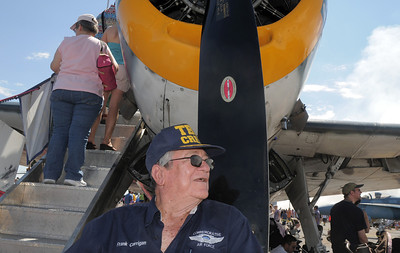 Frank Carrigan with the Commemorative Air Force, waits to take tickets for people looking at the Grumman TBM-3E airplane during Saturday's Rocky Mountain Airshow at Rocky Mountain Metropolitan Airport. August 27, 2011 staff photo/ David R. Jennings