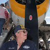 Frank Carrigan with the Commemorative Air Force, waits to take tickets for people looking at the Grumman TBM-3E airplane during Saturday's Rocky Mountain Airshow at Rocky Mountain Metropolitan Airport.<br /> August 27, 2011<br /> staff photo/ David R. Jennings