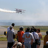 Gary Rower flies his Stearman airplane so the crowd can see during Saturday's Rocky Mountain Airshow at Rocky Mountain Metropolitan Airport.<br /> August 27, 2011<br /> staff photo/ David R. Jennings