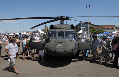 Lines from both directions of people formed to look at a Colorado National Guard helicopter during Saturday's Rocky Mountain Airshow at Rocky Mountain Metropolitan Airport. August 27, 2011 staff photo/ David R. Jennings