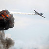 A Japanese World War II plane flies past an explosion for a reenactment of the Pearl Harbor attack during Saturday's Rocky Mountain Airshow at Rocky Mountain Metropolitan Airport.<br /> August 27, 2011<br /> staff photo/ David R. Jennings