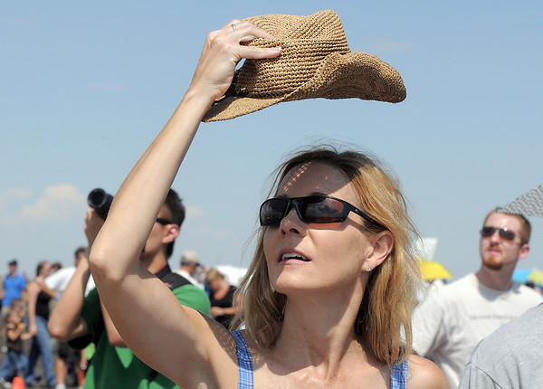 Dena Douglas, from Arvada, lifts her hat to see the aircraft performances during Saturday's Rocky Mountain Airshow at Rocky Mountain Metropolitan Airport.<br /> August 27, 2011<br /> staff photo/ David R. Jennings