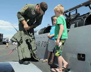 U.S. Airforce Major Byron Dobbs, left, shows Dawson Parker, 5, and his brother Noah, 7, high geforce pants  during Saturday's Rocky Mountain Airshow at Rocky Mountain Metropolitan Airport. August 27, 2011 staff photo/ David R. Jennings