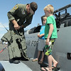 U.S. Airforce Major Byron Dobbs, left, shows Dawson Parker, 5, and his brother Noah, 7, high geforce pants  during Saturday's Rocky Mountain Airshow at Rocky Mountain Metropolitan Airport.<br /> August 27, 2011<br /> staff photo/ David R. Jennings