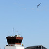 The U.S. Airforce B-2 bomber turns as it flies past the old control tower of Rocky Mountain Metropolitan Airport during Saturday's Rocky Mountain Airshow.<br /> August 27, 2011<br /> staff photo/ David R. Jennings